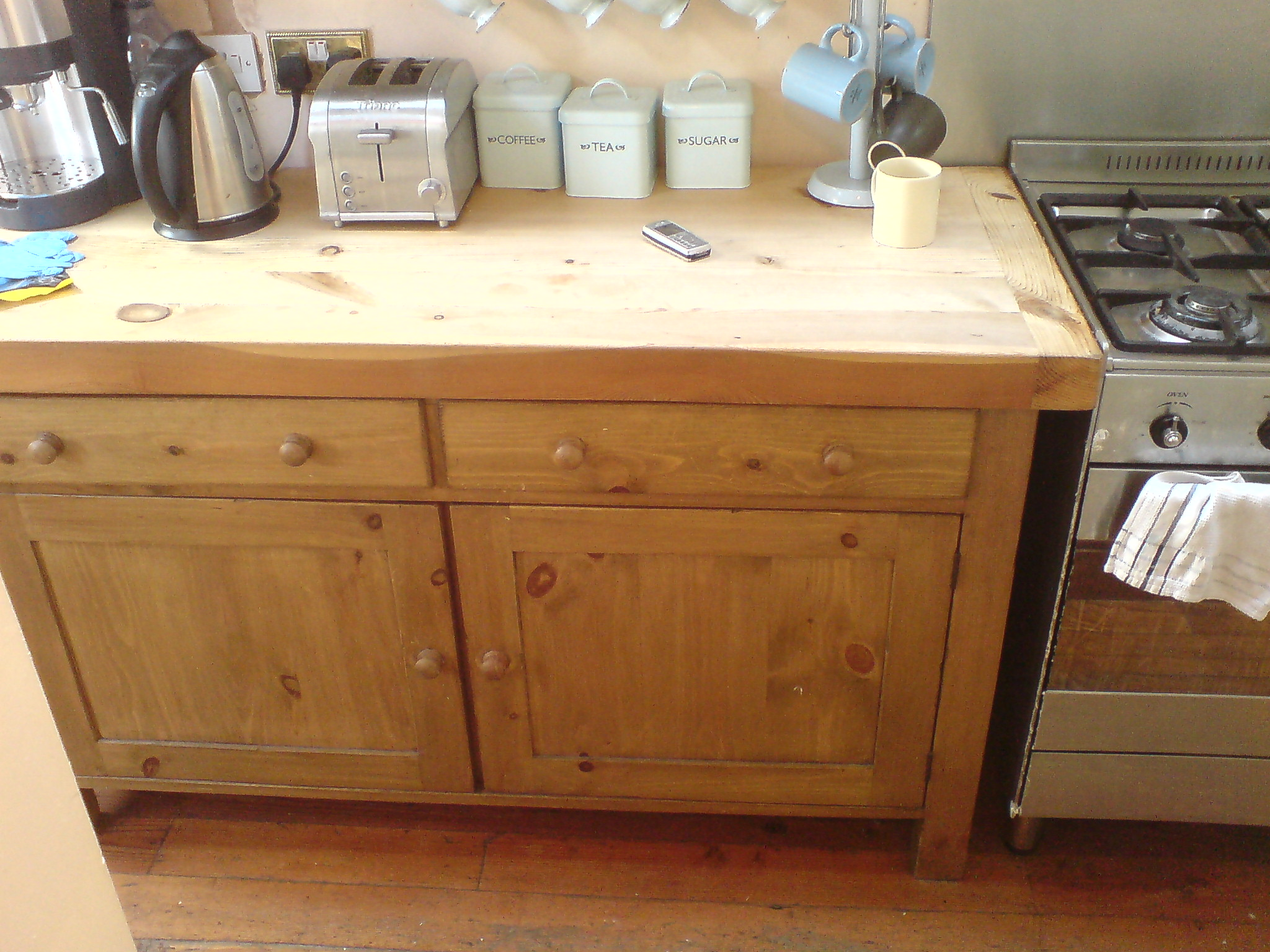 This Area Of The Kitchen Featured A Butchers Block Worktop Over Cupboard